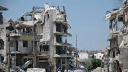 d9f87-syria_homs-residents-return-20140511-001