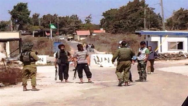Israeli soldiers speaking with foreign-backed terrorists in Golan
