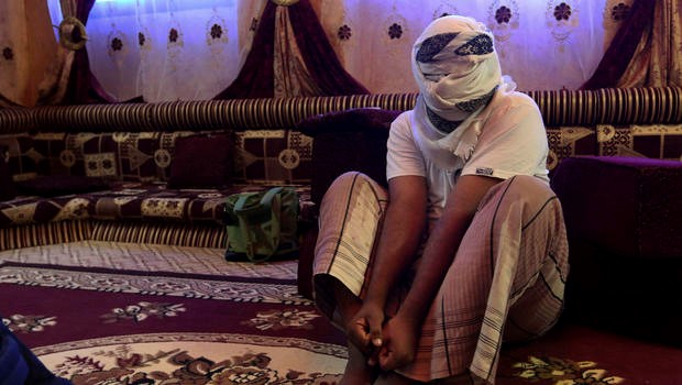 A former detainee shows how he was kept in handcuffs and leg shackles while held in a secret prison at Riyan airport in the Yemeni city of Mukalla in this May 11, 2017 photo.  (by AP)